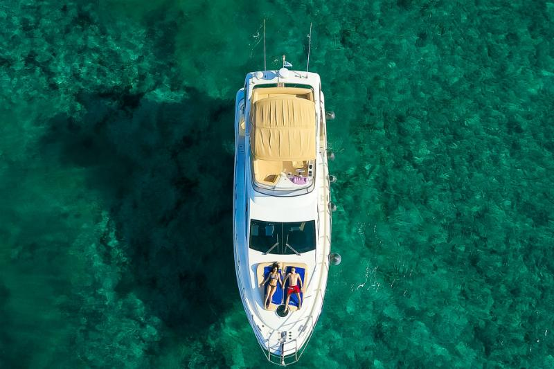 Cruising over of Santorini's crystal clear waters